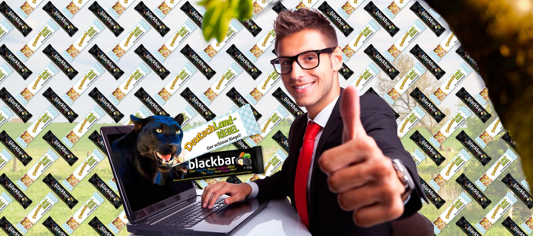 24/7 Internetshopping, DeutschLAnd-Riegel, blackbar, schwarzer Panther, Mann am Computer
